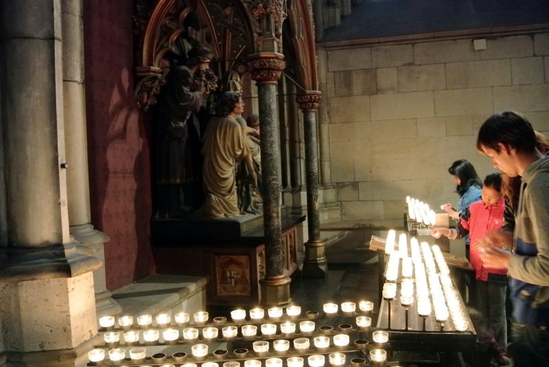 Tea lights in front of a side altar inside the cathedral